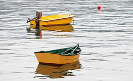 Couple of yellow boats Stock Images