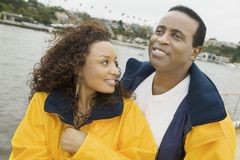 Couple In Yellow Jacket On The Yacht Stock Images