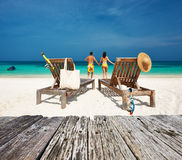 Couple in yellow relax on a beach at Maldives Royalty Free Stock Photos