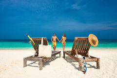 Couple in yellow running on a beach at Maldives Stock Image