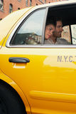 Couple In Yellow Taxi Stock Photos