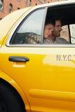 Couple In Yellow Taxi Stock Photos