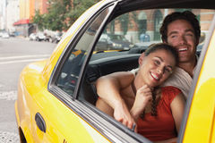 Couple In Yellow Taxi Stock Image