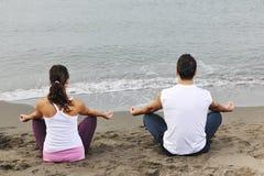 Couple yoga beach Royalty Free Stock Photo