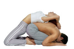 Couple yoga of man and woman. Two persons: Caucasian man and woman doing couple yoga stock photography