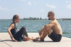 Couple Yoga, man and woman doing yoga exercises in the park royalty free stock image