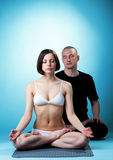 Couple of yoga trainers meditating in studio Stock Photo