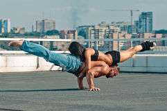 Couple yoga. Of women and men on the house-top Royalty Free Stock Photos