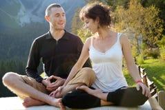 Couple yoga. Young couple doing yoga together Stock Image