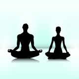 Couple of yogi. Man and woman are sitting in meditation pose Stock Image