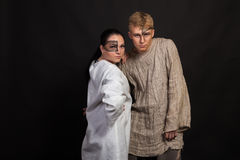 A couple of young actors on a dark background Royalty Free Stock Photo