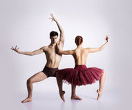 Couple of young and athletic ballet dancers. Image taken in the studio Royalty Free Stock Photos
