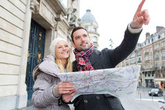 Couple of young attractive tourist watching map Stock Photos