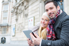 Couple of young attractive tourist watching tablet Stock Photo