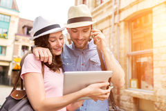 Couple of young attractive tourists discovering city on holidays stock images