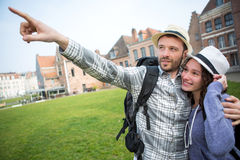 Couple of young attractive tourists discovering city Stock Photography