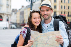 Couple of young attractive tourists watching map Stock Image