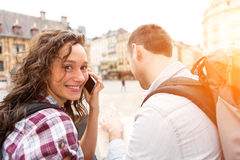 Couple of young attractive tourists watching map royalty free stock images