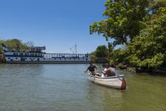 Couple with a young baby in a canoe in the Islets of Granada in the Lake Nicaragua, Nicaragua Royalty Free Stock Photography