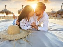 Couple young on beach lounge sunset. Vacation Royalty Free Stock Images