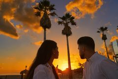 Couple young in beach vacation sunrise. Couple young in beach vacation looking sunrise in Spain Stock Photos