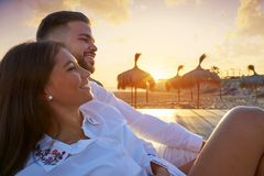 Couple young in beach vacation sunrise. Couple young happy in beach vacation sunrise at Spain Stock Image