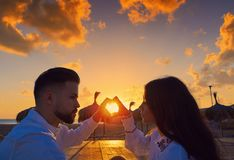 Couple young in beach vacation sunrise. Couple young heart symbol with hands at the beach vacation sunrise in Spain Royalty Free Stock Image