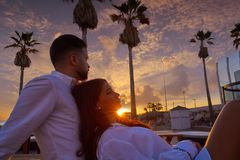 Couple young in beach vacation sunrise. Couple young hug in beach vacation sunrise in Spain Royalty Free Stock Photos