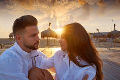 Couple young in beach vacation sunrise. Looking each other in Spain Stock Photos