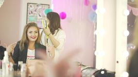 Couple of young beautiful women hairdresser stylist model dancing preparing for party celebration making salon hairstyle. Couple of young beautiful women stock footage