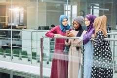 Couple young business muslim female using smart phone contact with partner. Couple young business muslim female entrepreneurs using smart phone contact with royalty free stock photography