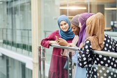 Couple young business muslim female using smart phone contact with partner