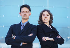A couple of young businesspeople in formal clothes Royalty Free Stock Images