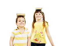 Couple young Children holding book on head Royalty Free Stock Image