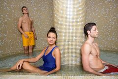 Couple young in cool spa water pool after sauna. Couple young in cool spa water round pool after sauna therapy Royalty Free Stock Photos