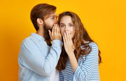 Couple of emotional people man and woman on yellow background stock photo