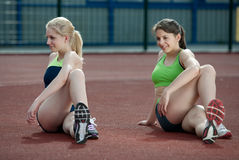 A couple of young female athletes stretching Stock Photography