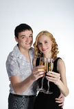 Couple of young girl and man drink champagne Stock Photography