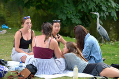 A couple of young girls have a social gathering in the Vondelpark in Amsterdam Stock Photo