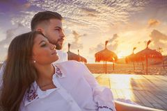 Couple young in beach vacation sunrise. Couple young happy in beach vacation sunrise at Spain Royalty Free Stock Images