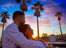 Couple young in beach vacation sunrise. Couple young hug in beach vacation sunrise in Spain Royalty Free Stock Photography