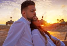 Couple young in beach vacation sunrise. Couple young hug in beach vacation sunrise in Spain Stock Image