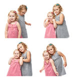 Couple of young little girls standing over isolated white background Royalty Free Stock Photography