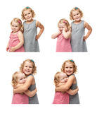 Couple of young little girls standing over isolated white background Stock Photography