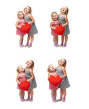 Couple of young little girls standing over isolated white background Royalty Free Stock Photos