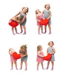 Couple of young little girls standing over isolated white background Royalty Free Stock Image