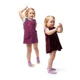 Couple young little girls standing over isolated white background Royalty Free Stock Photography