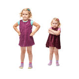 Couple young little girls standing over isolated white background Stock Photos