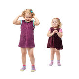 Couple young little girls standing over isolated white background Stock Image