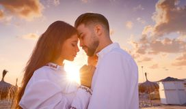 Couple young in love hug on the beach. Vacation sunrise in Spain Royalty Free Stock Photography